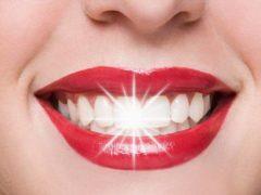 Причины темных пятен на зубах и их лечение